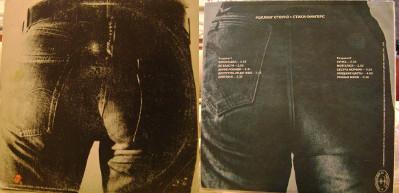 """detalhe da """"traseira"""" do disco original e russo"""